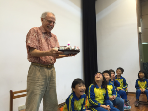 Dr. Jackson celebrating his 72nd birthday with school children
